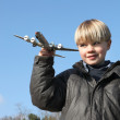 Little boy playing with toy plane — Stock Photo