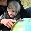 Father and son looking at a globe — Stock Photo #9808831