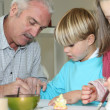 Brother and sister painting with grandpa — Stock Photo