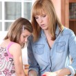 Mother teaching her child how to cook — Stock Photo