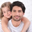 Girl hugging father — Stock Photo