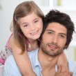 Stock Photo: Little girl hugging her dad