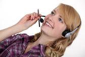 Woman wearing a telephone headset — Stock Photo