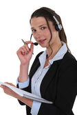 Telephony operator with notebook — Stock Photo