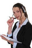 Telephony operator with notebook — Stock Photo