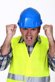 A furious construction worker. — Stock Photo