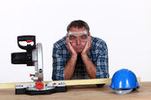A fed-up and bored tradesman — Stock Photo