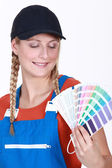 Woman choosing which color paint to use — Stock Photo