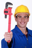 Young man holding wrench — Stock Photo