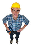 Jonge handelaar houden een machtshulpmiddel — Stockfoto