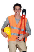 Worker in a reflective vest with helmet and boltcutters — Stock Photo