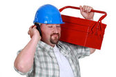Tradesman pretending to listen to music — Stock Photo