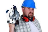 Bearded man holding circular-saw — Stock Photo