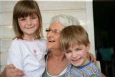 Grandmother looking after grandchildren — Stock Photo