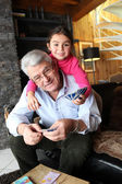 Little girl playing cards with grandpa — Stock Photo