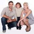 Studio shot of parents and their young son — Stock Photo