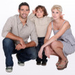 Stock Photo: Studio shot of parents and their young son