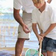 Father teaching son to fish with net — Stock Photo
