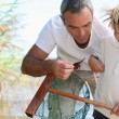 Father and son fishing with net — Stock Photo