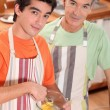 Grandfather and grandson in the kitchen — Stock Photo