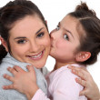 Little girl kissing her mother — Stock Photo #9811298