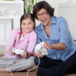 Girl and her grandmother playing computer games — Stock Photo