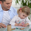 Father and daughter drawing — Stock Photo #9812150