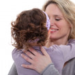 Portrait of young mother with daughter showing their affection — Stock Photo