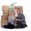 Family celebrating on moving day — Stock Photo