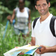 Couple  hiking with a map — Stock Photo