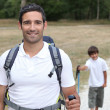Father and son hiking - Foto Stock