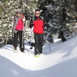 Couple walking in snowshoes — Stock Photo #9816296