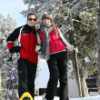 Couple enjoying skiing trip - Stock Photo