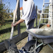 Man preparing cement - Stock Photo