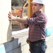 Builder working on a house - Stock Photo