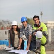 Three construction workers sharing their ideas — Stock Photo #9816498