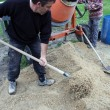 Stock Photo: Men mixing cement