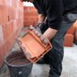 Stock Photo: Mason spreading cement on brick