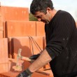 Builder shaping brick — Stock Photo #9816634