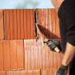 Stock Photo: Mason cementing between bricks