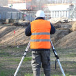 A land surveyor using an altometer - Stock Photo