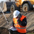 Stock Photo: Site surveyor taking readings