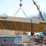 Crane lifting side of house — Stock Photo #9817003