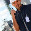 Worker on site with a walkie talkie — Stock Photo