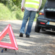 Hazard triangle at a breakdown - Stock Photo