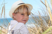 Blond boy surrounded by reeds — Stock Photo