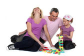 Family playing with building blocks — Stock Photo