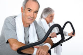 Senior couple doing cardio machine — Stock Photo