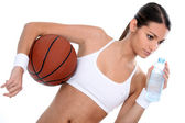 Woman holding basketball and bottle of water — Stock Photo