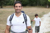 Father and son hiking — Stock Photo
